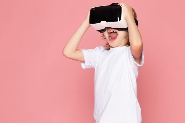 A front view screaming boy blonde haired adorable sweet playing vr on the pink space