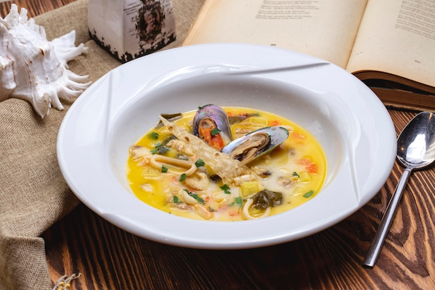 Front view seafood soup with mussels