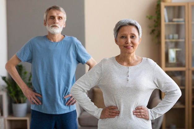 Front view senior couple training together