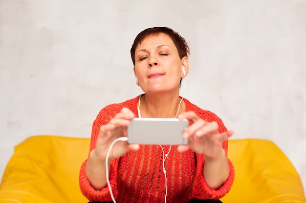 Front view senior woman taking selfies