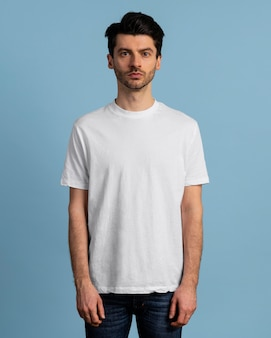 Front view of serious man posing in t-shirt