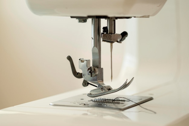 Front view of sewing machine with needle
