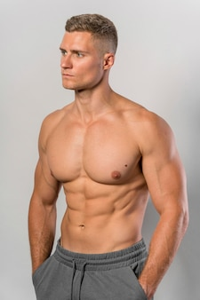 Front view of shirtless fit man posing