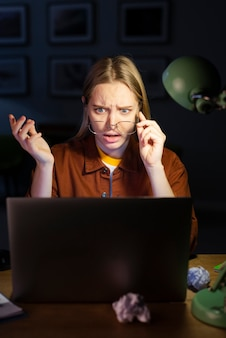 Front view of shocked woman with glasses