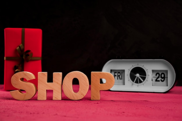 Front view of shop word on plain table