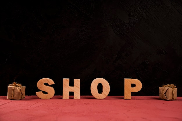 Front view of shop word on red table