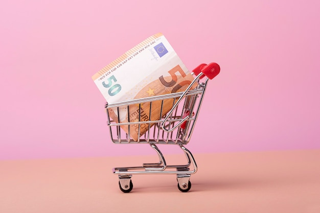 Front view of shopping cart with banknotes