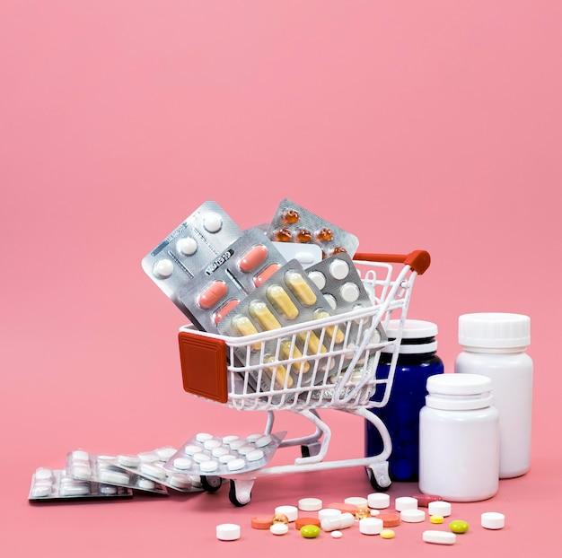 Front view of shopping cart with pill foils and containers
