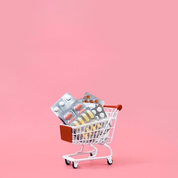 Front view of shopping cart with pill foils and copy space