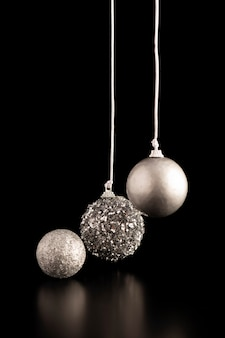 Front view of silver hanging christmas globes