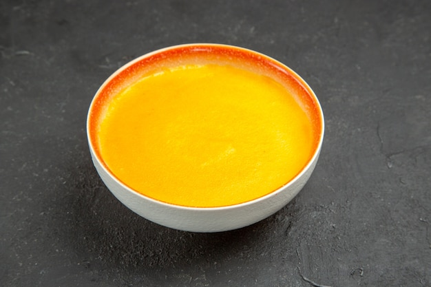 Front view simple pumpkin soup inside plate on grey table