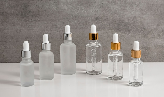 Front view skin oil droppers arrangement on table