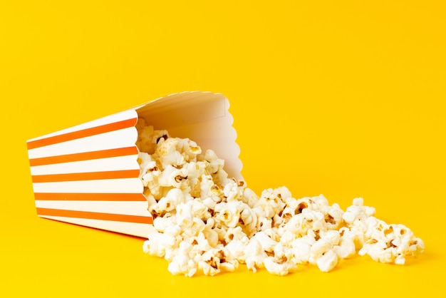 A front view slated popcorn inside package spread all on yellow
