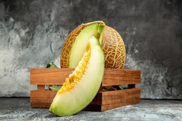 Front view sliced fresh melon on dark-light background Free Photo