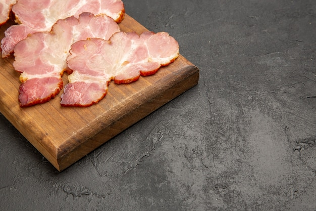 Front view sliced ham on wooden desk and the grey photo color meat food meal raw pig