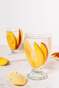 Front view slices of mango in a glass