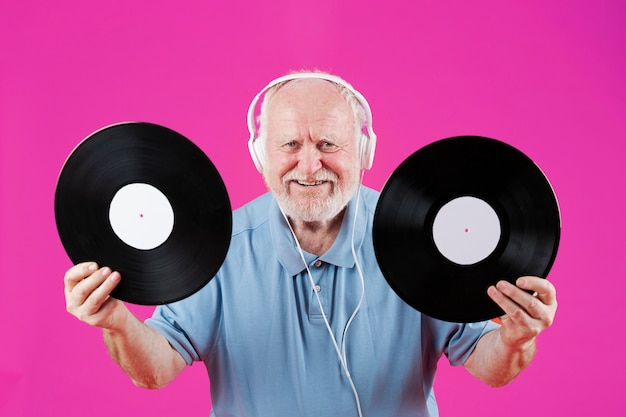 Front view smiley elder holding music records