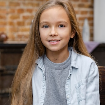 Front view of smiley girl with long hair