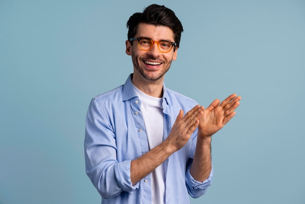 Front view of smiley handsome man with glasses