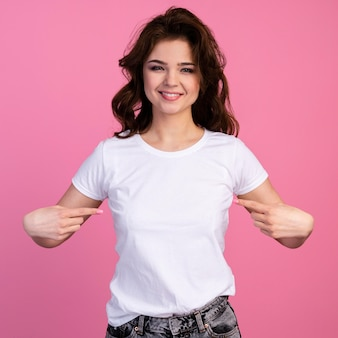 Front view of smiley woman pointing to herself