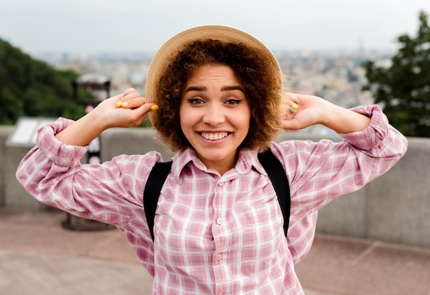 Front view smiley woman wearing a hat
