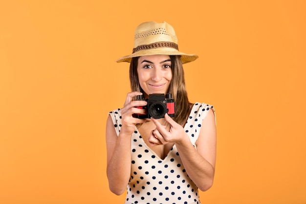 Front view smiley woman with camera