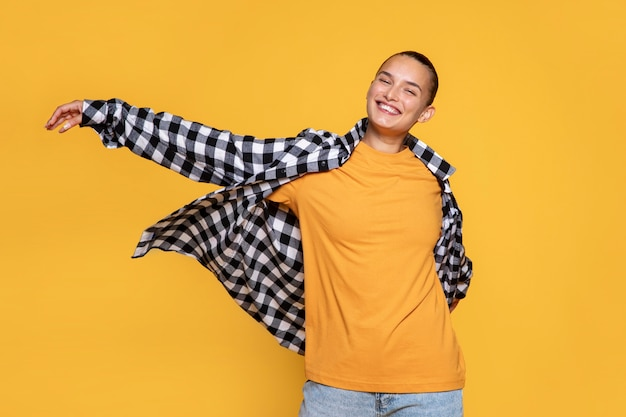 Front view of smiley woman with checkered shirt