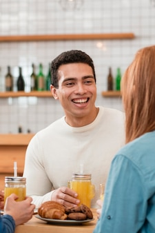 Front view of smiling boy in cafe