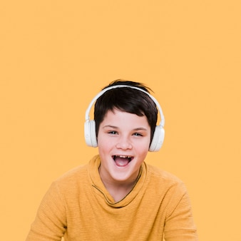 Front view of smiling boy with headphones