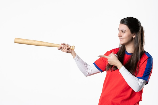 Front view smiling female player with baseball bat
