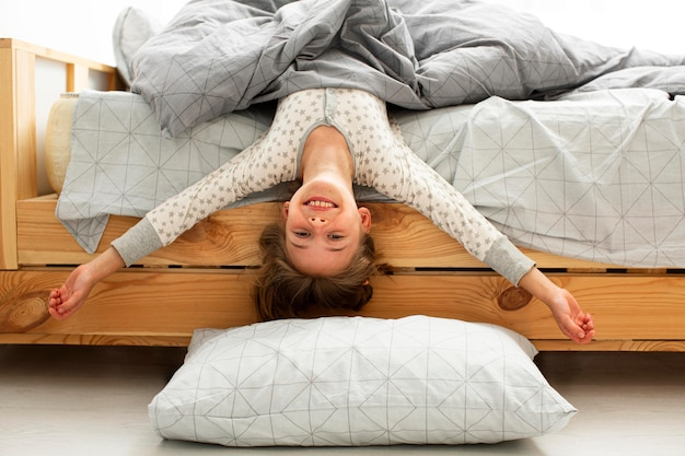 Front view of smiling girl in bed