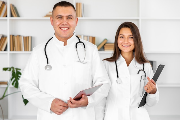 Front view smiling male and female doctor