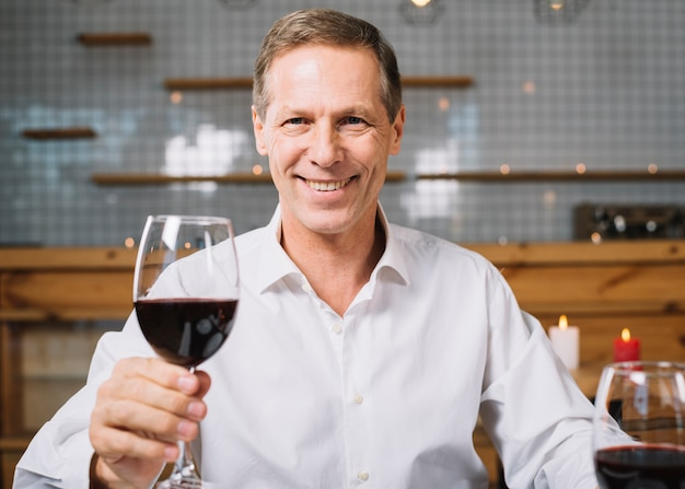 Front view of smiling man at dinner