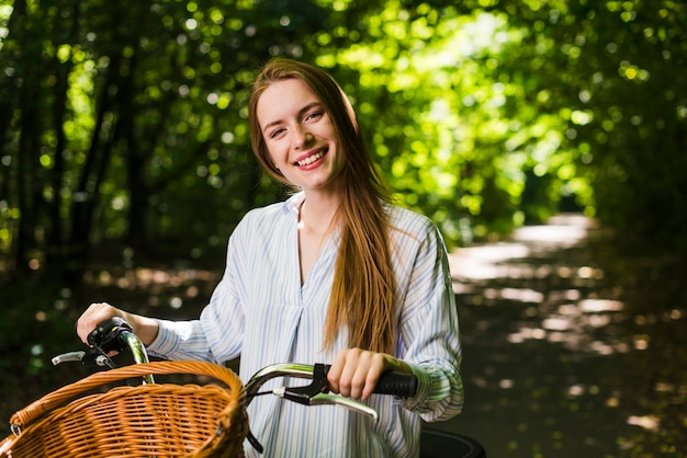 Front view smiling woman on bike