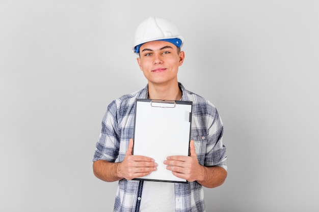 Front view of smiling young man holding a clipboard