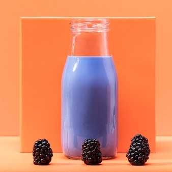 Front view smoothie in bottle with blackberries
