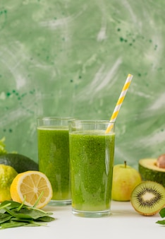 Front view smoothie glasses with lemon and kiwi
