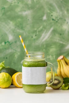Front view smoothie jar with bananas and kiwi
