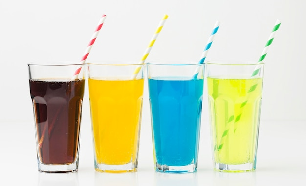 Front view of soft drinks in glasses with straws