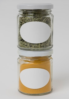 Front view spices in jars with labels