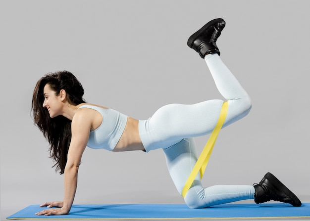 Front view of sporty woman doing exercises