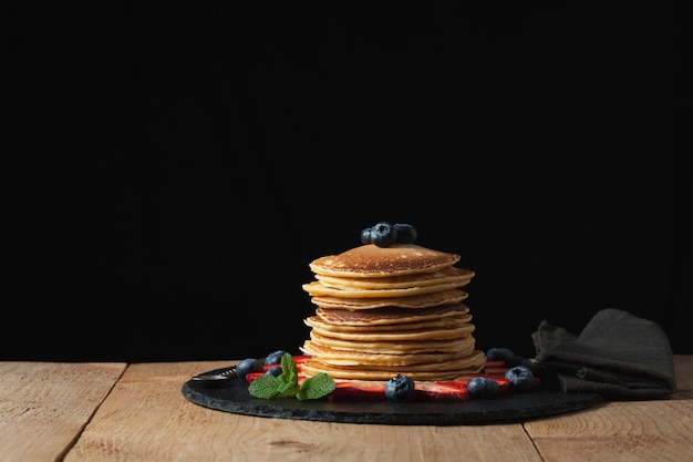 Front view of stack of homemade plain pancakes.