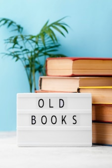 Front view of stacked books with light box
