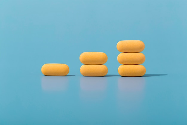 Front view of stacked pills in ascending order