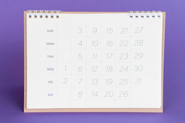 Front view stationery calendar on violet background
