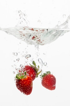 Front view of strawberries in water