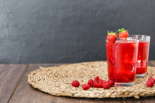 Front view of strawberry cocktails with copy space