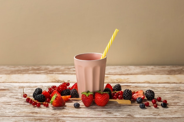 Front view strawberry smoothie in cup