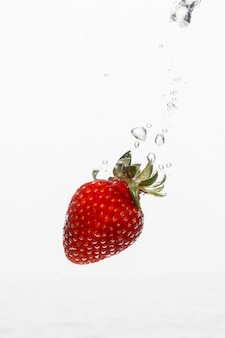 Front view of strawberry in water with copy space