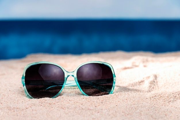 Front view of sunglasses on beach sand